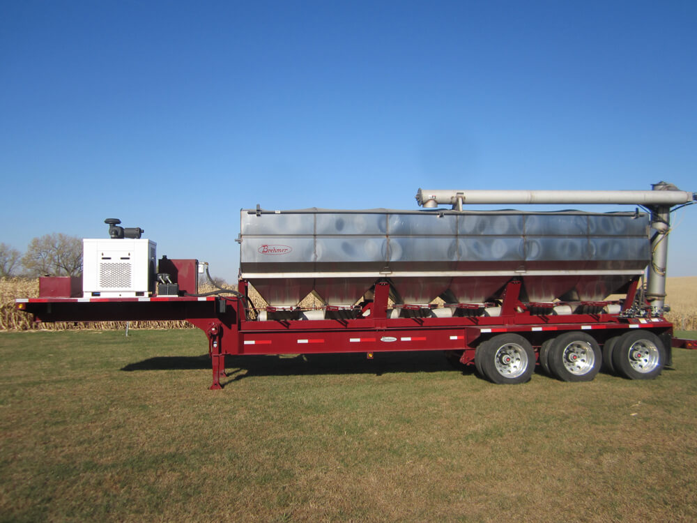 Overhead discharge trailer mounted fertilizer tender